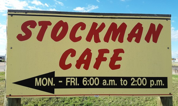 Road Sign pointing to Stockman Cafe